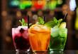 Glasses of cocktails on bar background - 81524138