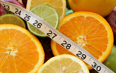 Healthy food choices - measuring tape and fruit