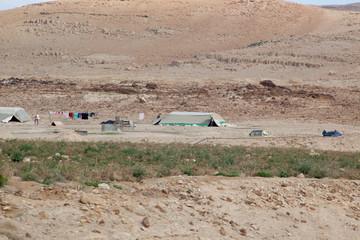 Nomad tents in dry Jordan landscape