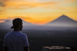 Man and Volcano Agung as Background.