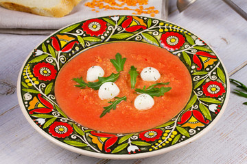 Red lentil and tomato soup with mozzarella
