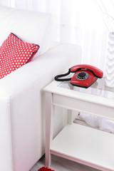 Retro phone on nightstand in room