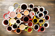 canvas print picture - Many cups of coffee on wooden table, top view