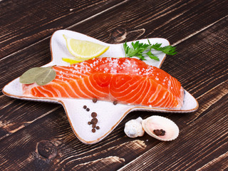 Fresh salmon over wooden background