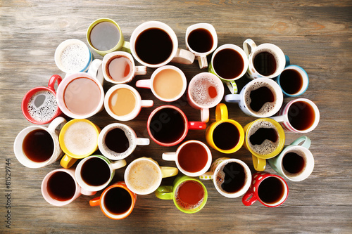 Many cups of coffee on wooden table, top view - 81529744