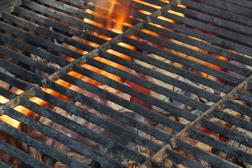 Empty Charoal Grill With Flames Of Fire