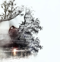 abstract double exposure of woman and nature at the sunset on th