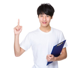 Young man with clipboard and finger point up