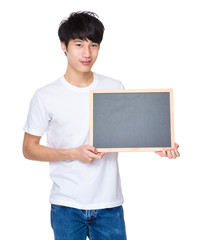 Young man show with chalkboard