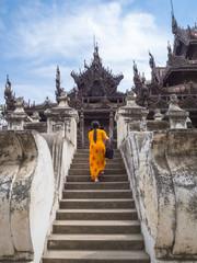 Myanmarese woman walking into Shwenandaw Monastery