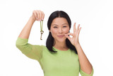 Woman locked mouth with key on white