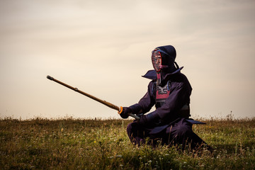 Kendo fighter with shinai