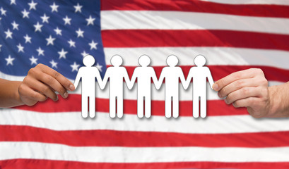 hands holding people pictogram over american flag
