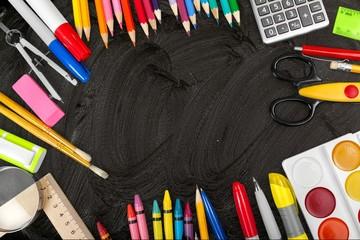 School. School supplies on blackboard background ready for your