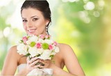 Bride. Young attractive bride with the bouquet of white roses