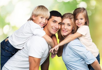 Son. Cheerful young family looking at camera together on white
