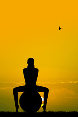 Pilates silhouette at sunset