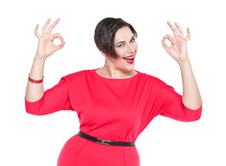 Beautiful plus size woman with ok gesture with her hands isolate