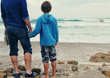 father and son walking on the beach