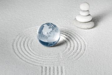 Glass globe in zen garden World harmony concept