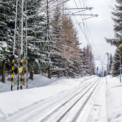 free railway in winter time in mountains