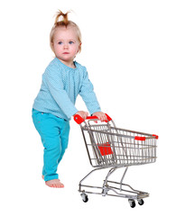 little girl holding the shopping trolley