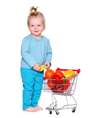 little girl with shopping trolley isolated on white