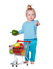 little girl with shopping trolley full of vegetables and fruits