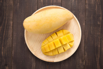 Top shot mango on a wood background
