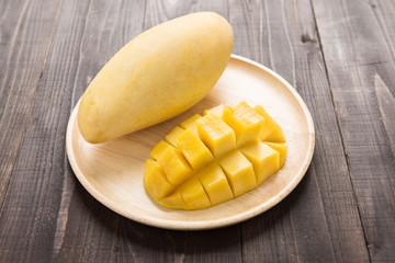 Mango on a wood background