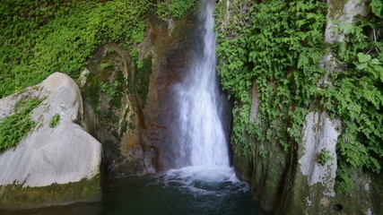 Waterfall in natural grot.  Spain