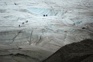 Hikers on the immense Kennicott glacier. Wrangell St Elias NP