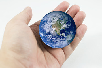 Earth in hand Elements of this image furnished by NASA