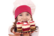 happy little girl cook with sweet raspberry cake