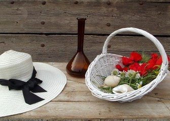still life with poppies and a hat