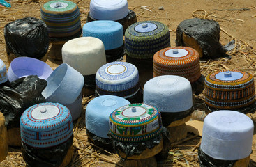 Sales of Taqiyah (muslim cap) on  on a stand in Cameroon market.