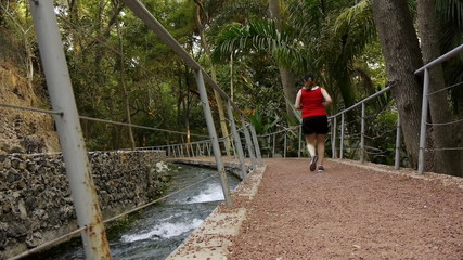 Overweight Woman Jogging On Path