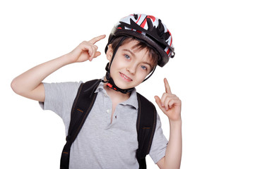 smiling little cyclist pointing on his helmet