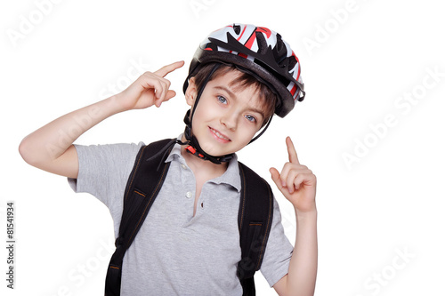 smiling little cyclist pointing on his helmet - 81541934