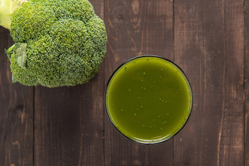 Broccoli juice on wood table.