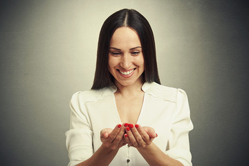 woman folded her hands and looking