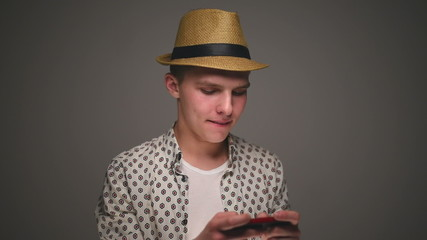 Hipster man playing on mobile phone