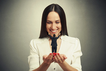 woman holding small man on the palm