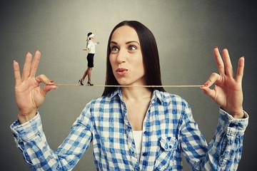 woman looking at small walking woman
