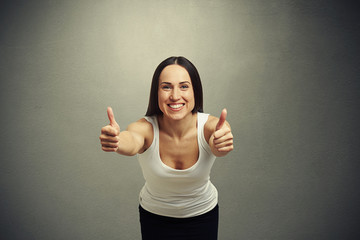 woman stretching forward and showing thumbs up