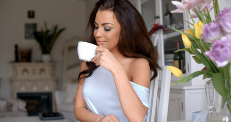 Graceful attractive woman drinking a cup of tea