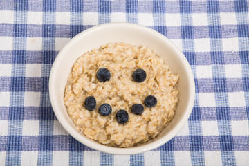 Oatmeal in Bowl with Blueberry Smiley Face
