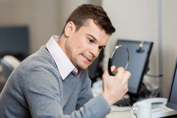 Frustrated Customer Service Representative Holding Headphones