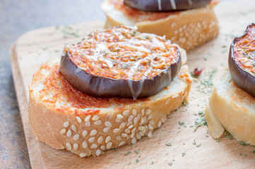 Snacks from baguette with eggplant and cheese