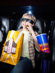 Boy Eating Popcorn In 3D Movie Theater